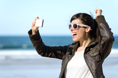Woman taking photo with phone Stock Images