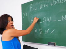 Woman having fun with words on chalkboard stock photo