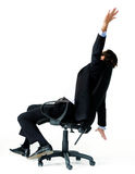 Fun at work. Restless office worker turns in his seat and throws his arms in the air stock photos