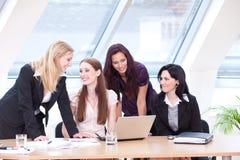 Fun at work break. Business women having fun in the work break stock image