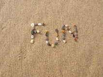 Fun written with stones and shells Stock Image