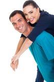 Fun couple piggyback Stock Photos