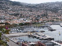 Funchal is the Capital of the island of Madeira. The harbour is always busy. Funchal is the Capital of the island of Madeira. The distinctive houses and roofs Stock Images
