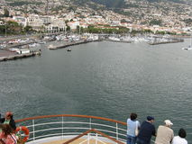 Funchal harbour. Passengers on cruise ship enjoying departing scene of Funchal harbour in the Atlantic Portuguese archipelago of Madeira Royalty Free Stock Images