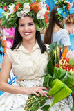 Funchal, Madeira - April 20, 2015: A beautiful young woman in the Madeira Flower Festival 2015. Royalty Free Stock Images