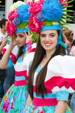 Funchal, Madeira - April 20, 2015: Beautiful young women with flower headdress at the Madeira Flower Festival, P. Funchal, Madeira - April 20, 2015: Beautiful Royalty Free Stock Image