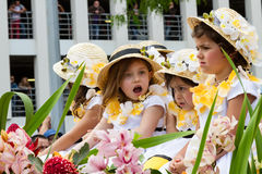 Funchal, Madeira - April 20, 2015: Children in floral costumes at the Flower Festival Parade, Madeeira, Portugal Royalty Free Stock Images