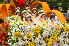 Funchal, Madeira - April 20, 2015: Children in a Floral Float at the Madeira Flower Festival Stock Photos