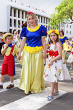 Funchal, Madeira - April 20, 2015: Woman and children with colorful floral costumes at the Madeira Flower Festival Royalty Free Stock Photo