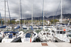 FUNCHAL, MADEIRA - APRIL 22, 2015:Yachts moored in Funchal seaport, Madeira island, Portugal. Royalty Free Stock Images