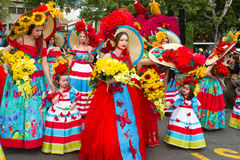 Funchal, Madeira - April 20, 2015: Young women and children with colorful floral costumes at the Madeira Flower Festival, Funchal, Stock Image