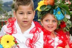 Funchal, Madeira - 20 de abril de 2015: Crianças em trajes florais no festival da flor, Funchal, Madeira, Portugal Imagem de Stock