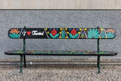 Artistically painted wooden bench  on Avenida Arriaga in Funchal. Madeira, Portugal. Funchal, Madeira, Portugal - April 19, 2018: Artistically painted wooden stock images