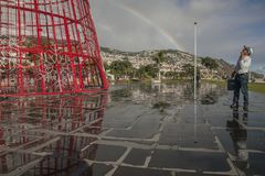Funchal, Madeira, Portugal - a red, metal Christmas tree and a rainbow; sunny day. royalty free stock images