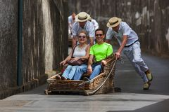 FUNCHAL, MADEIRA - SEPTEMBER 19: Traditional downhill sledge trip on September 19, 2016 in Madeira, Portugal.  royalty free stock photos