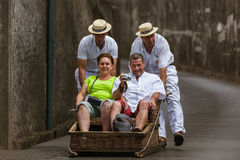 FUNCHAL, MADEIRA - SEPTEMBER 19: Traditional downhill sledge tri Stock Photo