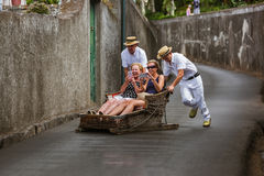 FUNCHAL, MADEIRA - SEPTEMBER 19: Traditional downhill sledge trip on September 19, 2016 in Madeira, Portugal.  stock photos