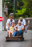 FUNCHAL, MADEIRA - SEPTEMBER 19: Traditional downhill sledge trip on September 19, 2016 in Madeira, Portugal.  royalty free stock image
