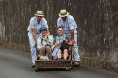FUNCHAL, MADEIRA - SEPTEMBER 19: Traditional downhill sledge trip on September 19, 2016 in Madeira, Portugal.  stock photo