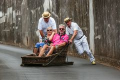 FUNCHAL, MADEIRA - SEPTEMBER 19: Traditional downhill sledge trip on September 19, 2016 in Madeira, Portugal.  royalty free stock photography