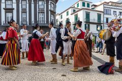 Folk musicians and dancers performing on the Avenida Arriaga  in Funchal on the Madeira Island, Portugal. Stock Photo