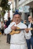 Folk musicians and dancers performing on the Avenida Arriaga  in Funchal on the Madeira. Funchal, Portugal - April 19, 2018:  Folk musicians and dancers stock photography