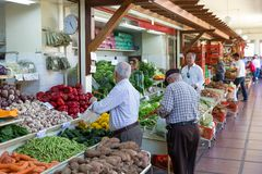 FUNCHAL, PORTUGAL - MAY 02: Unknown people visiting the vegetable market of the famous Mercado dos Lavradores on May 02, 2014 in F Royalty Free Stock Photos