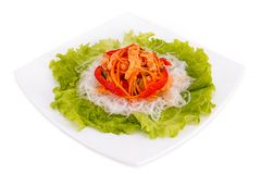 Funchoza Salad on lettuce leaves. On white background Stock Photos