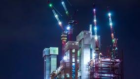 funcionamento da noite do local da construção civil do lapso de tempo 4K filme