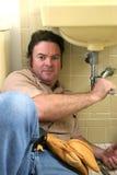 Funcionamento do canalizador Foto de Stock