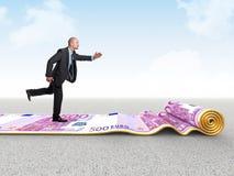 Funcionamento do dinheiro Fotos de Stock Royalty Free