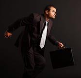 Funcionamiento competitivo del hombre de negocios Foto de archivo