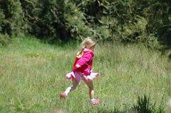 Funcionamiento de la muchacha Foto de archivo