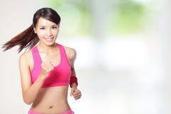 Funcionamiento de la muchacha del deporte de la salud Imágenes de archivo libres de regalías