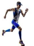 Funcionamiento de los corredores del atleta del hombre del hierro del triathlon del hombre Imagen de archivo libre de regalías