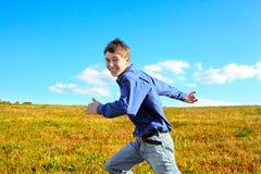 Funcionamiento del adolescente Foto de archivo libre de regalías