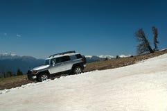Funcionamiento del rastro de la nieve Imagen de archivo