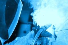 Funcionamiento del soldador. Imagen de archivo