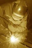 Funcionamiento del soldador. Foto de archivo