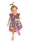 Funcionamiento feliz de la niña pequeña Fotografía de archivo libre de regalías
