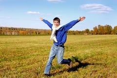 Funcionamiento feliz del adolescente Imágenes de archivo libres de regalías