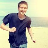 Funcionamiento feliz del adolescente Fotografía de archivo libre de regalías