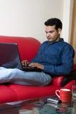 Funcionamiento indio joven del hogar Fotos de archivo