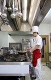 Funcionamiento joven del cocinero Imagen de archivo libre de regalías