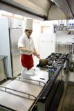 Funcionamiento joven del cocinero Fotografía de archivo libre de regalías
