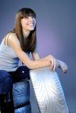 Funcionamiento y sonrisa alegres de la muchacha Imagen de archivo