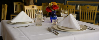 Function Place Settings. Place settings at a restaurant in a function room Royalty Free Stock Image