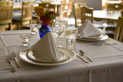 Function Place Settings. Place settings at a restaurant in a function room Stock Image