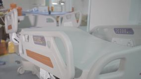 Functional beds and medical devices in modern intensive care unit. Ultrasound machine in a modern operating laboratory stock footage