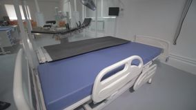 Functional Beds and Medical Devices in Modern Intensive Care Unit. Ultrasound machine in a modern operating laboratory stock video footage
